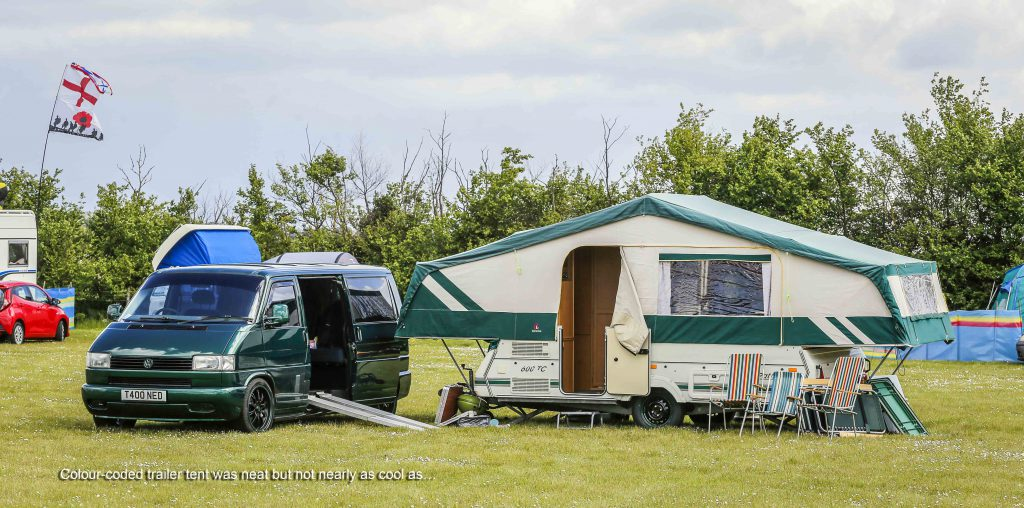 Green VW T4 Transporter with matching trailer tent